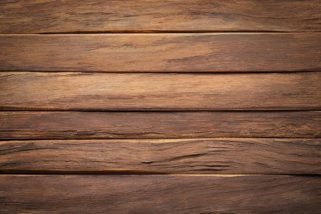 木の質感の背景。空きスペースのある天然木で作られた暗い板