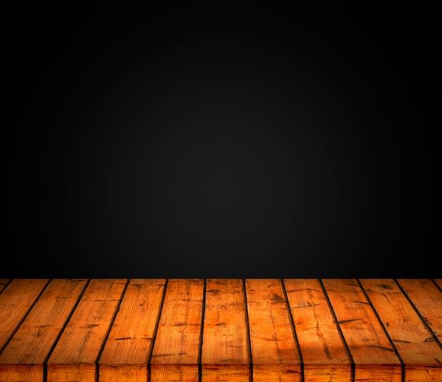 Wood texture background with dark gradient.