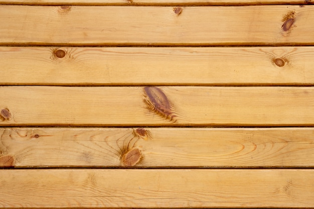 Wood texture background. wooden panel with gaps, planks and chinks.