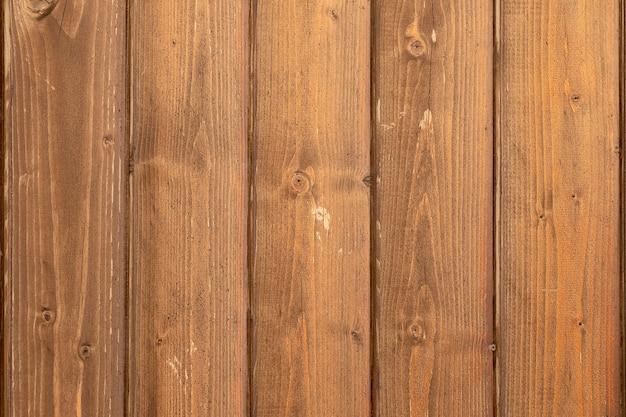 Текстура дерева, натуральный темный деревянный фон, уложенный по диагонали.
