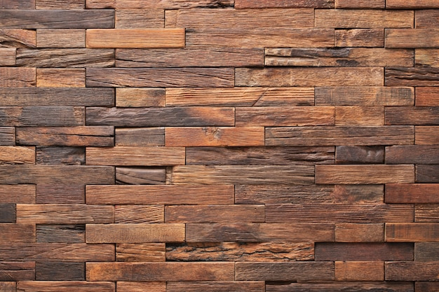 Wood texture wall panel made of small planks. brown planks as background