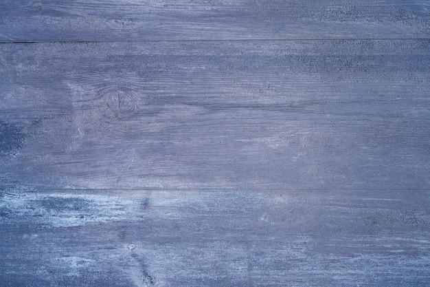 ぼろぼろの青いペンキの上面図のコピースペースと木の質感