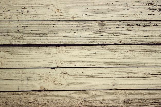 デザインと装飾のための天然木模様の木目調。ダークブラウンの木の背景。天然チーク材の背景。寄木細工の床のテクスチャの背景をラミネートします。木の質感。