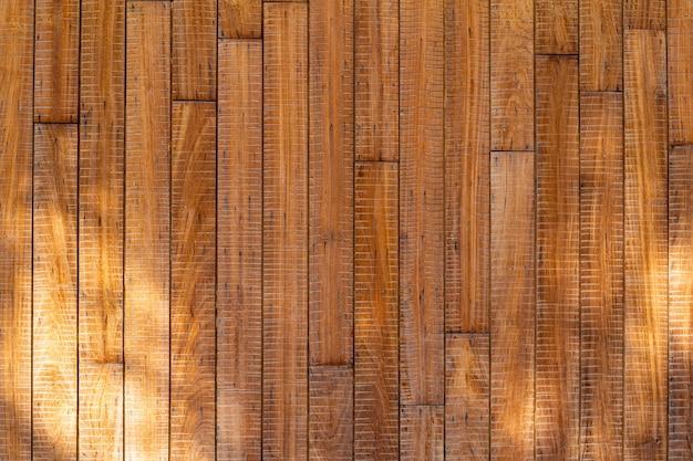 Текстура древесины с фоном солнечного света