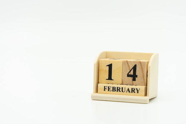 Wood word 14 february on calendar. day 14 meets valentine day.