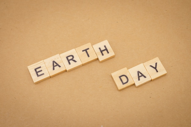 Wood word earth day using as background universal day concept and earth day concept