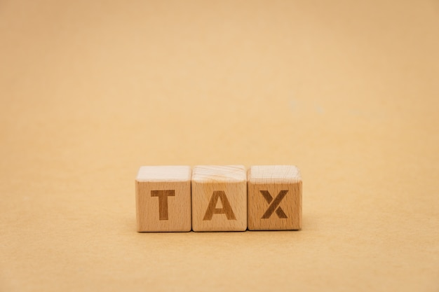 Wood word tax standing on background isolate. using as background business