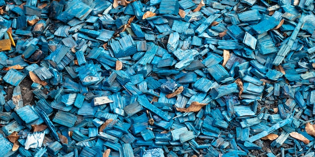 Woodchips texture. lumber, blue wooden background. surface of timber, wood waste.