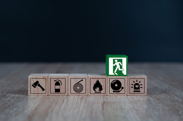 Wooded blocks stacking with fire escape icon.