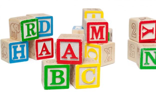Wooden alphabet blocks isolated on white