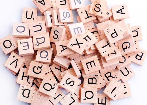 Wooden alphabet blocks on white table