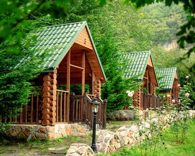 Wooden arbors among trees and mountains