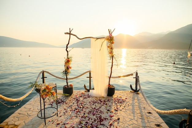 Wooden arch for the wedding ceremony at sunset