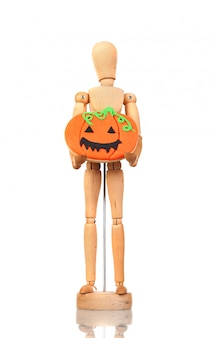 Wooden articulated doll holding a pumpkin cookie