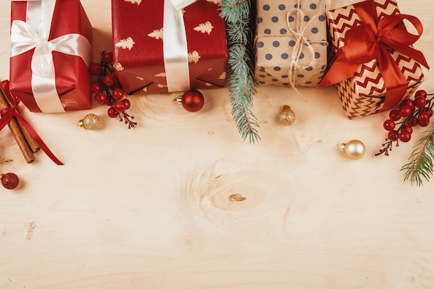 Wooden background copy space with christmas gifts and decorations for your design