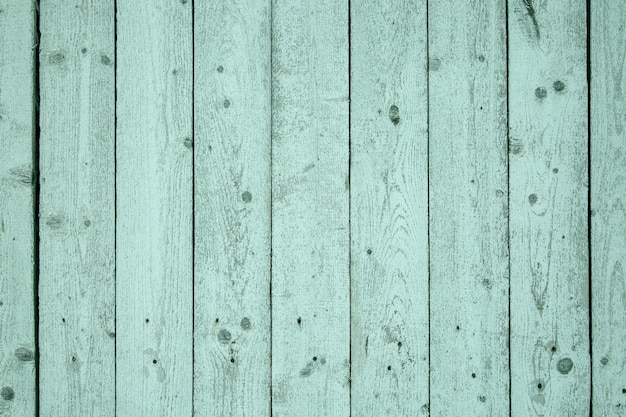 Деревянный фон из светло-зеленых окрашенных досок. текстура дерева.