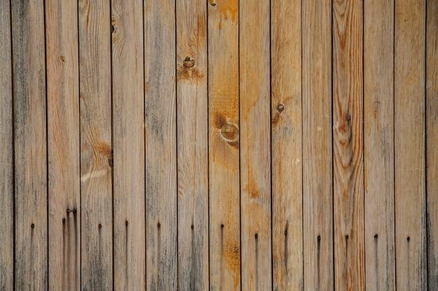 Деревянный фон из старых бежевых досок. текстура дерева.