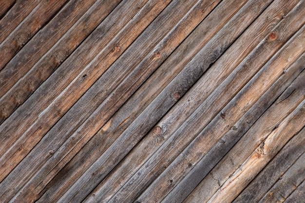 Деревянный фон из старых досок, расположенных по диагонали. текстура дерева.