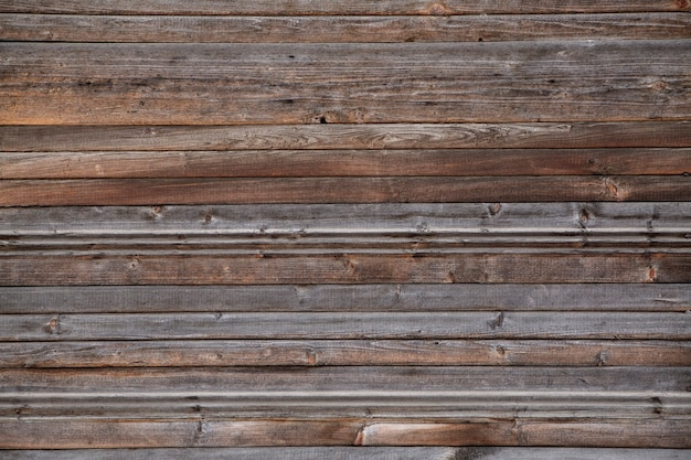 Деревянный фон из старых серых досок, расположенных горизонтально. текстура дерева.