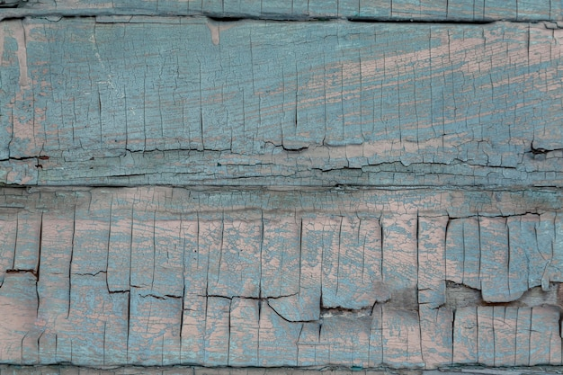 Деревянный фон из старых досок, покрытых синей краской. текстура дерева.