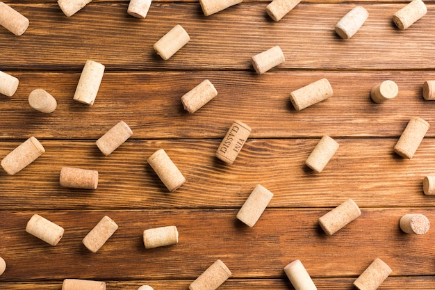 Wooden background full of wine corks