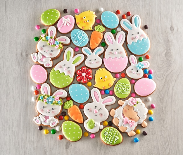 Wooden background of homemade glazed easter cookies