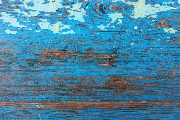 Деревянный фон синего цвета в стиле гранж старой гнилой деревянной доске
