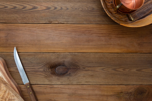 Wooden background. kitchen utensils, wooden plates and knife.