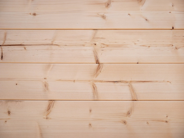 Wooden background. natural pattern of natural pine. the texture of the unpainted wood.