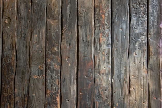 텍스트에 대 한 장소를 가진 오래 된 까맣게 탄된 널빤지 원활한 질감의 나무 배경