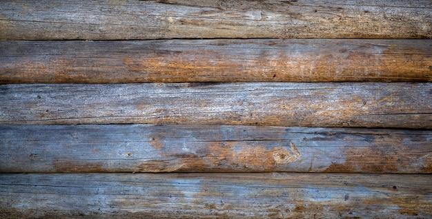 木製の背景。テクスチャを持つ素朴な家の古い木製の壁