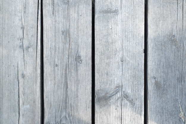 Wooden background, outside. gray vertical boards, close-up. rough, cracked wood panels. textured back