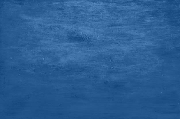 木製の背景。ヴィンテージの素朴な質感、トレンディなモノクロブルーと落ち着いた色の壁紙。トップビュー、コピースペース。