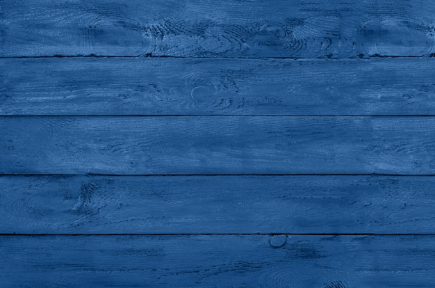 Wooden background. vintage rustic texture, wallpaper in trendy monochrome blue and calm color. top view, copy space.