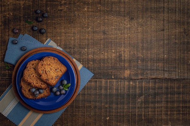 Wooden background with delicious snack