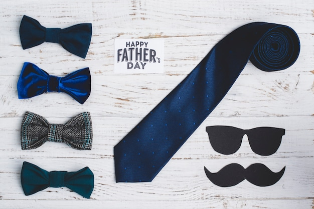 Wooden background with father's day objects