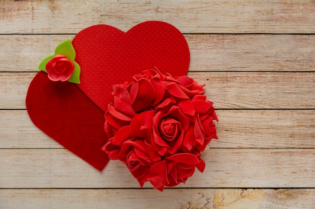 Wooden background with flowers and hearts. the concept of valentine day.