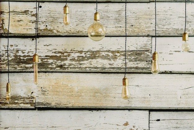 Wooden background with light bulbs of different sizes for decoration.