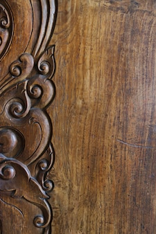 Wooden background with vintage ornament decoration
