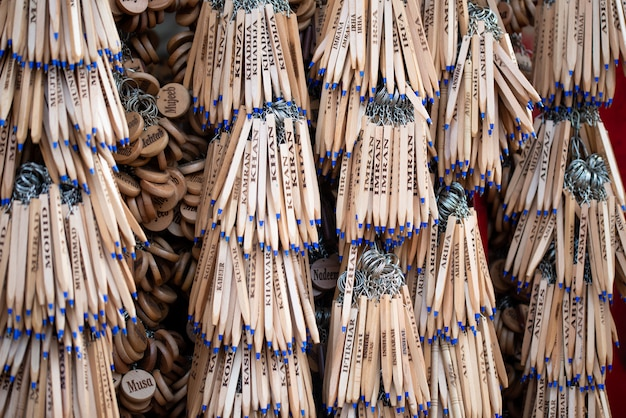 Wooden ball pen hanging in a shop in the tourist market. people's names written on it.