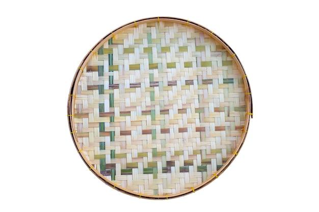 Wooden bamboo threshing basket on white wall.