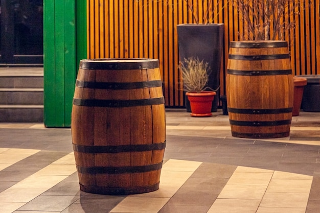 Wooden barrel on the summer terrace of the restaurant.