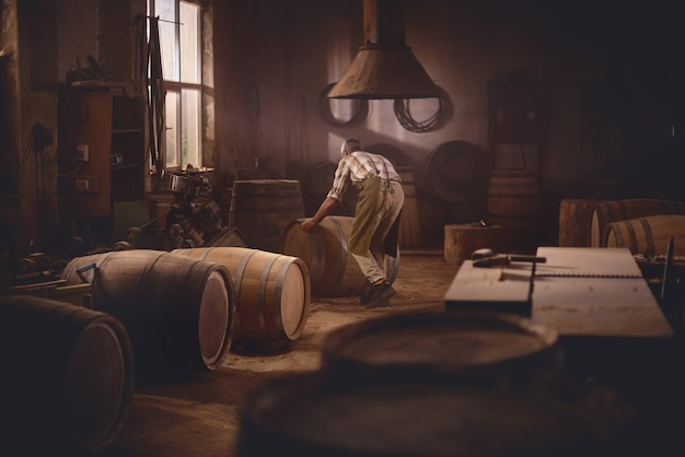Wooden barrels in a cooperage, barrel workshop
