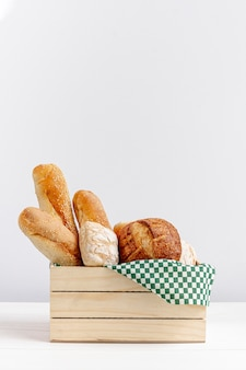 Wooden basket with bread copy space