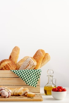 Wooden basket with variety of bread