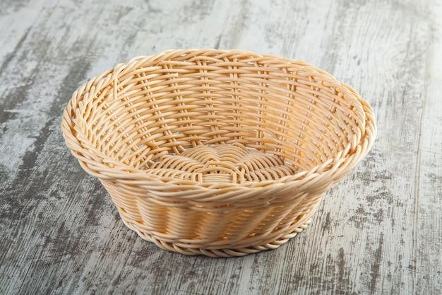 Wooden basket on wooden background