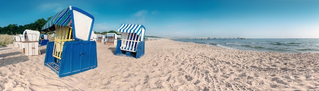 Wooden beach chairs on the coast of baltic sea