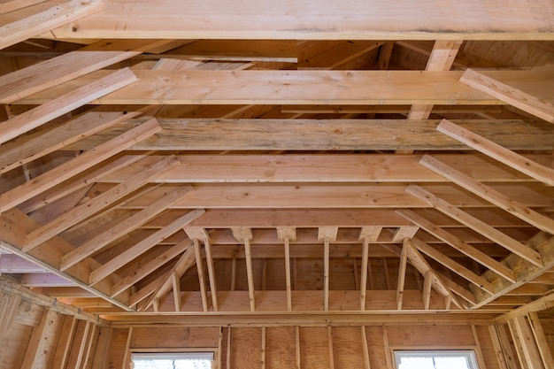 Wooden beams ceiling framed building under construction interior residential home