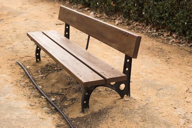 Wooden bench in the city park outdoors