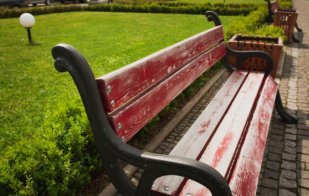 Wooden bench in the city park with cobbles. outdoor shot